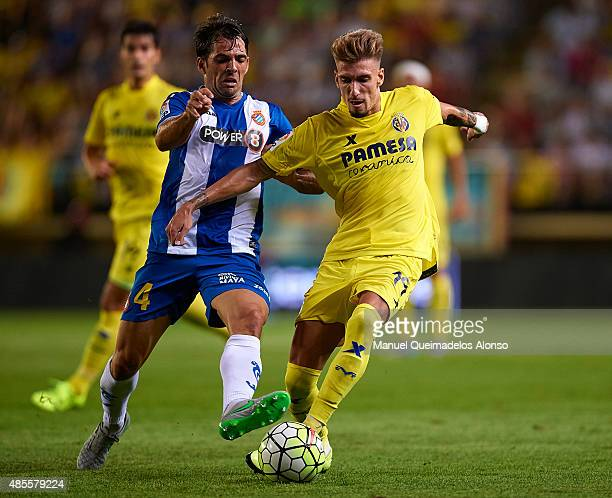 Samuel Castillejo of Villarreal battle for the ball with Victor Sanchez of Espanyol during the La Liga match between Villarreal CF and RCD Espanyol...