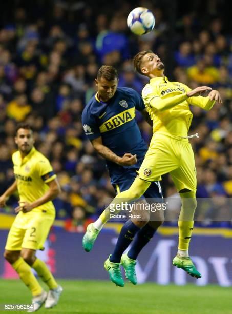Samuel Castillejo of Villarreal CF and Edwin Cardona of Boca Juniors go for a header during the international friendly match between Boca Juniors and...