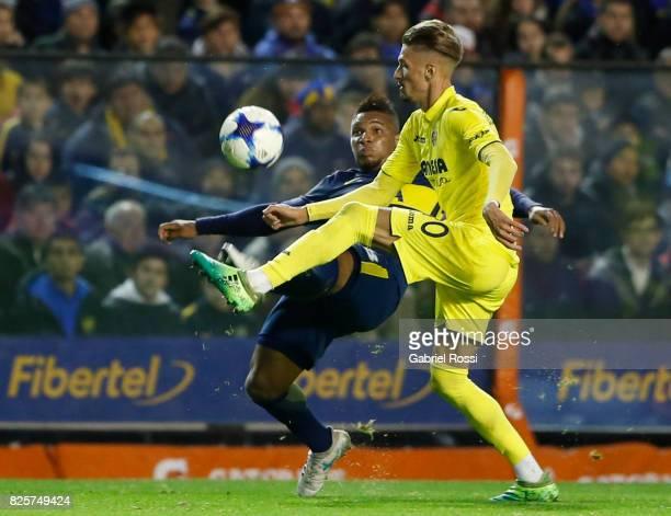 Samuel Castillejo of Villarreal CF fights for the ball with Frank Fabra of Boca Juniors during the international friendly match between Boca Juniors...