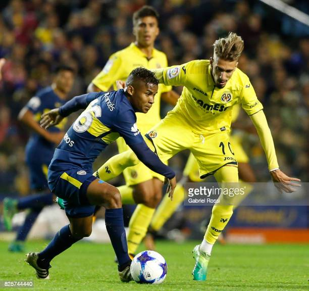 Samuel Castillejo of Villarreal CF fights for the ball with Wilmar Barrios of Boca Juniors during the international friendly match between Boca...