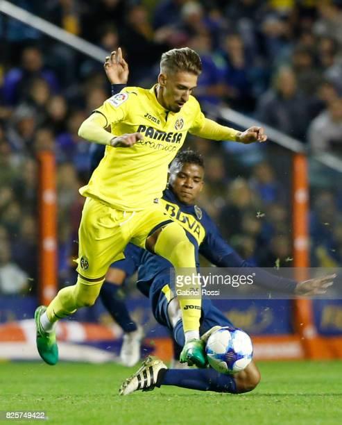 Samuel Castillejo of Villarreal CF fights for the ball with Wilmar Barrios of Boca Juniors during the international friendly match between Boca...