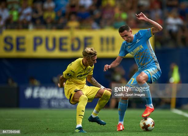 Samuel Castillejo of Villarreal competes for the ball with Askhat Tagybergen of Astana during the UEFA Europa League group A match between Villarreal...