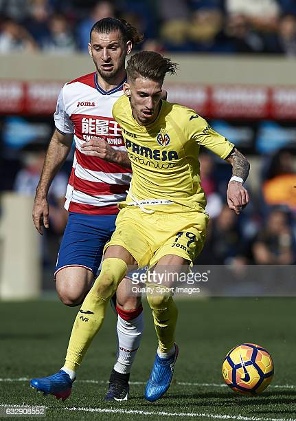 Samuel Castillejo of Villarreal competes for the ball with Gaston Silva of Granada during the La Liga match between Villarreal CF and Granada CF at...