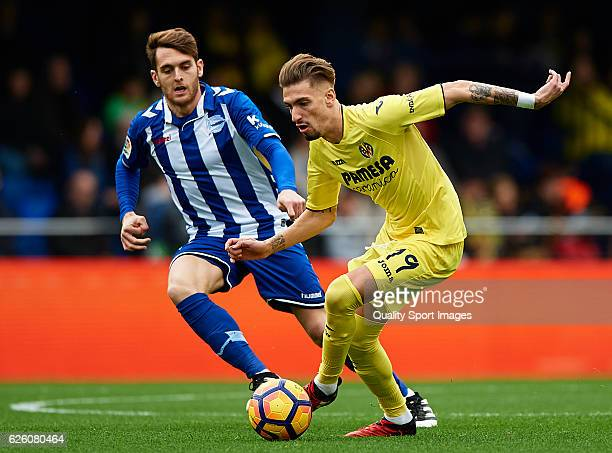 Samuel Castillejo of Villarreal competes for the ball with Ibai Gomez of Deportivo Alaves during the La Liga match between Villarreal CF and...