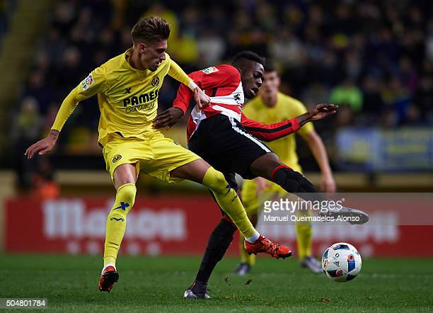 Samuel Castillejo of Villarreal competes for the ball with Inaki Williams of Athletic Club during the Copa del Rey Round of 16 second leg match...