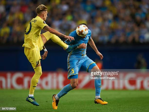 Samuel Castillejo of Villarreal competes for the ball with Marin Anicic of Astana during the UEFA Europa League group A match between Villarreal CF...