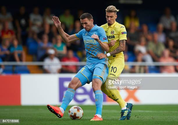 Samuel Castillejo of Villarreal competes for the ball with Serikzhan Muzhikov of Astana during the UEFA Europa League group A match between...