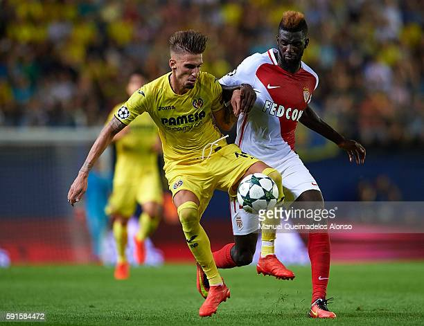 Samuel Castillejo of Villarreal competes for the ball with Tiemoue Bakayoko of Monaco during the UEFA Champions League playoff first leg match...