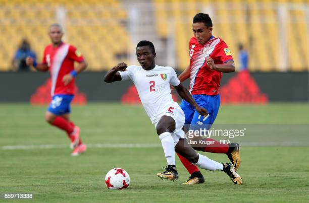 Samuel Conte of Guinea controls the ball from Sebastian Castro of Costa Rica during the FIFA U17 World Cup India 2017 group C match between Costa...