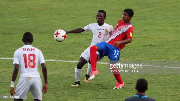 Samuel Conte of Guinea is challenged by Yecxy Jarquin of Costa Rica during the FIFA U17 World Cup India 2017 group C match between Costa Rica and...
