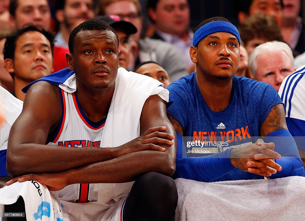 Samuel Dalembert and Carmelo Anthony of the New York Knicks look on against the Toronto Raptors at Madison Square Garden on October 13 2014 in New...