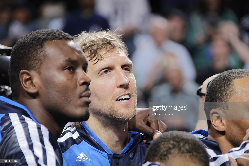 <a gi-track='captionPersonalityLinkClicked' href=/galleries/search?phrase=Samuel+Dalembert&family=editorial&specificpeople=202026 ng-click='$event.stopPropagation()'>Samuel Dalembert</a> #1 and <a gi-track='captionPersonalityLinkClicked' href=/galleries/search?phrase=Dirk+Nowitzki&family=editorial&specificpeople=201490 ng-click='$event.stopPropagation()'>Dirk Nowitzki</a> #41 of the Dallas Mavericks look on from the bench against the Los Angeles Lakers on November 5, 2013 at the American Airlines Center in Dallas, Texas.