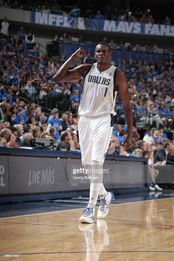 Samuel Dalembert of the Dallas Mavericks celebrates a win against the San Antonio Spurs during Game Three of the Western Conference Quarterfinals...