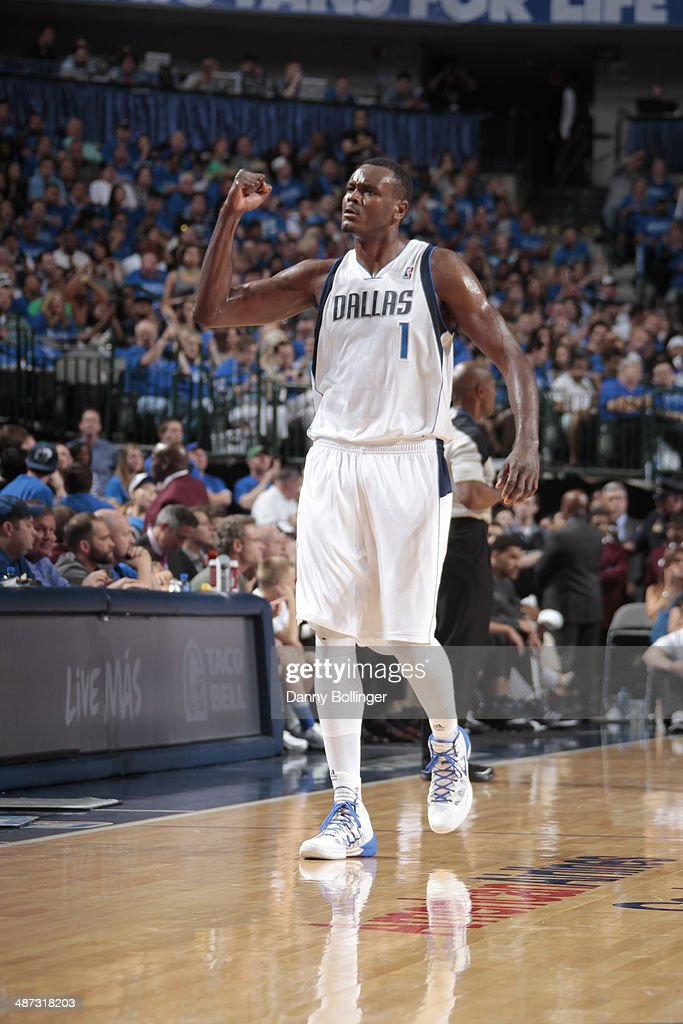 Samuel Dalembert of the Dallas Mavericks celebrates against the San Antonio Spurs during Game Three of the Western Conference Quarterfinals during...