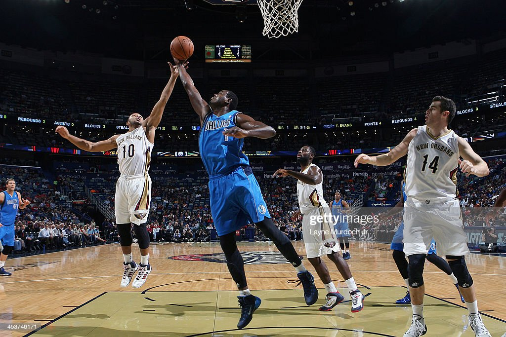 <a gi-track='captionPersonalityLinkClicked' href=/galleries/search?phrase=Samuel+Dalembert&family=editorial&specificpeople=202026 ng-click='$event.stopPropagation()'>Samuel Dalembert</a> #1 of the Dallas Mavericks grabs the rebound against <a gi-track='captionPersonalityLinkClicked' href=/galleries/search?phrase=Eric+Gordon&family=editorial&specificpeople=4212733 ng-click='$event.stopPropagation()'>Eric Gordon</a> #10 of the New Orleans Pelicans on December 4, 2013 at the New Orleans Arena in New Orleans, Louisiana.