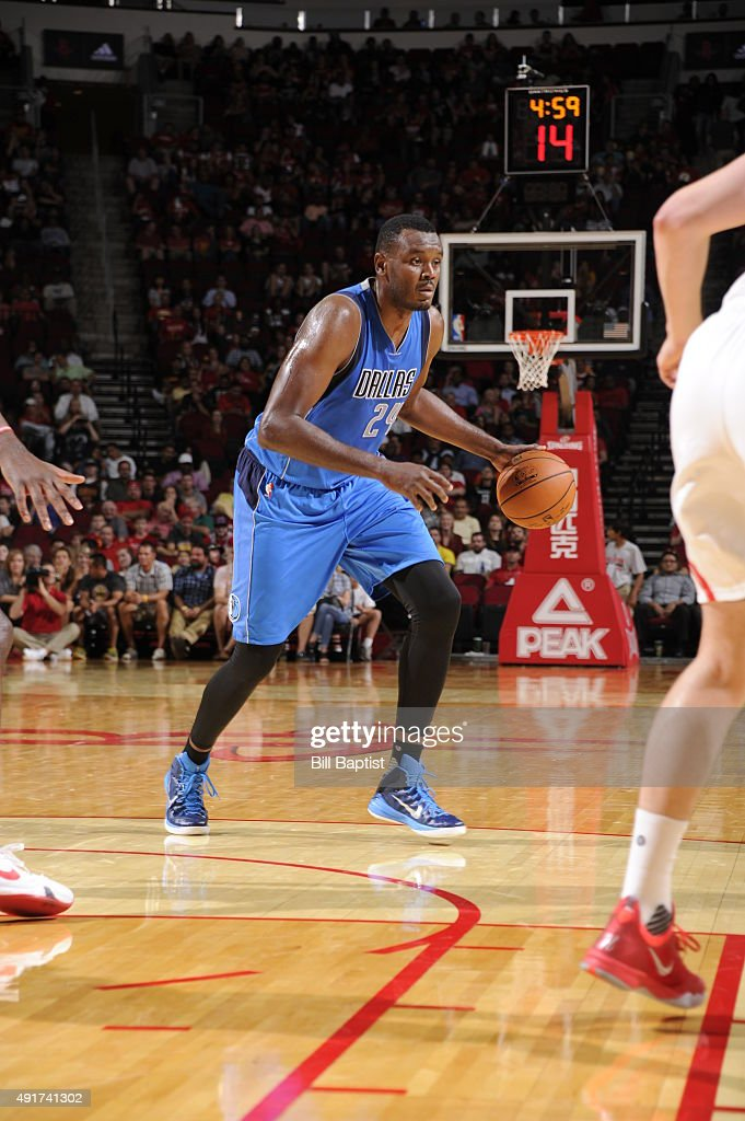 Samuel Dalembert of the Dallas Mavericks handles the ball against the Houston Rockets during a preseason game on October 7 2015 at the Toyota Center...