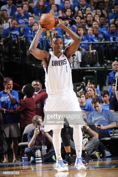 Samuel Dalembert of the Dallas Mavericks looks to pass the ball against the San Antonio Spurs during Game Three of the Western Conference...