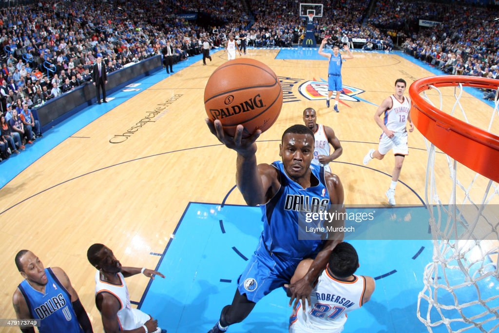 Samuel Dalembert of the Dallas Mavericks shoots against the Oklahoma City Thunder on March 16 2014 at the Chesapeake Energy Arena in Oklahoma City...
