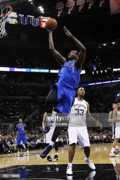 Samuel Dalembert of the Dallas Mavericks shoots against the San Antonio Spurs in Game Seven of the Western Conference Quarterfinals during the 2014...