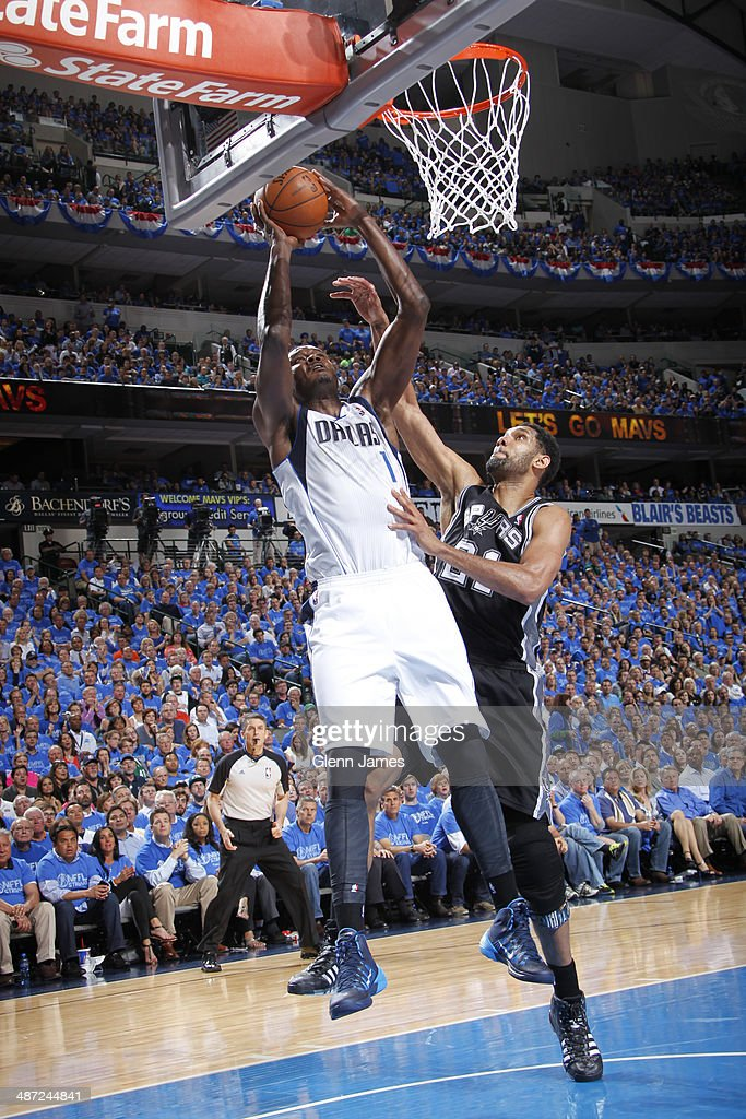 Samuel Dalembert of the Dallas Mavericks shoots against Tim Duncan of the San Antonio Spurs during Game Four of the Western Conference Quarterfinals...