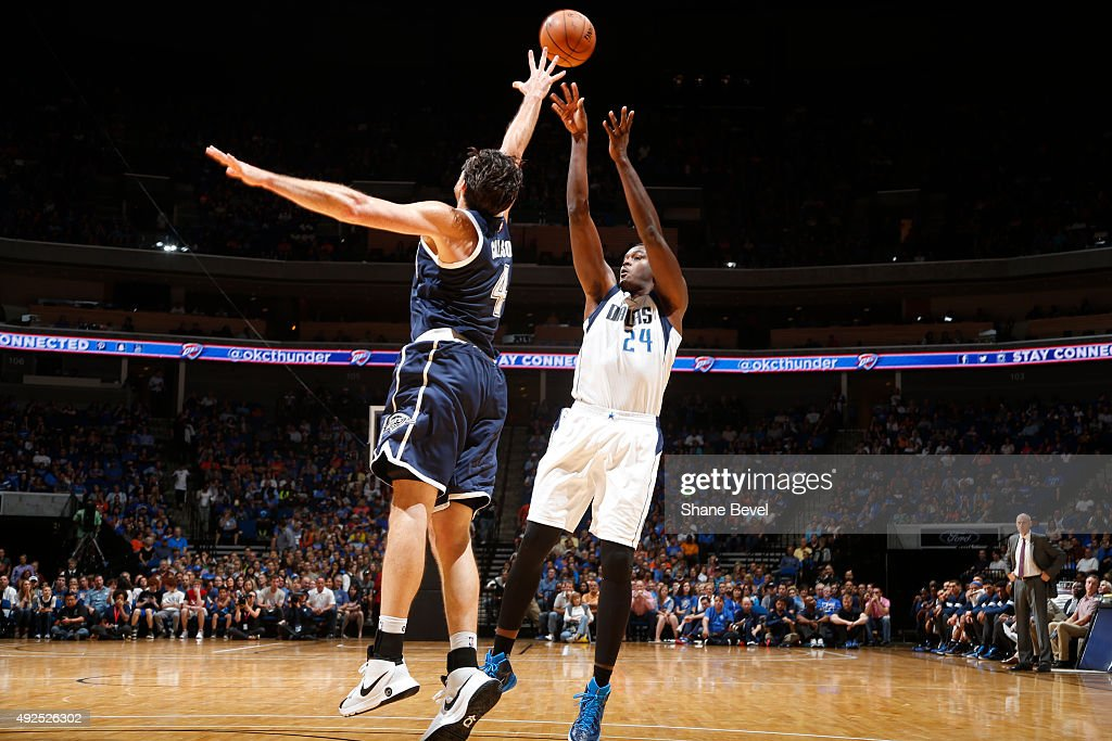 Samuel Dalembert of the Dallas Mavericks shoots the ball against the Oklahoma City Thunder during a preseason game on October 13 2015 at the BOK...
