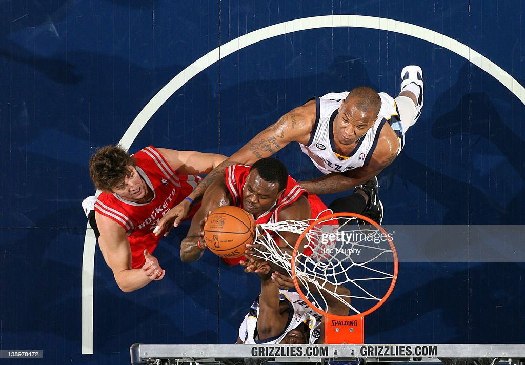 <a gi-track='captionPersonalityLinkClicked' href=/galleries/search?phrase=Samuel+Dalembert&family=editorial&specificpeople=202026 ng-click='$event.stopPropagation()'>Samuel Dalembert</a> #21 of the Houston Rockets grabs a rebound and gets his hand stuck in the net against <a gi-track='captionPersonalityLinkClicked' href=/galleries/search?phrase=Marreese+Speights&family=editorial&specificpeople=4187263 ng-click='$event.stopPropagation()'>Marreese Speights</a> #5 of the Memphis Grizzlies on February 14, 2012 at FedExForum in Memphis, Tennessee.