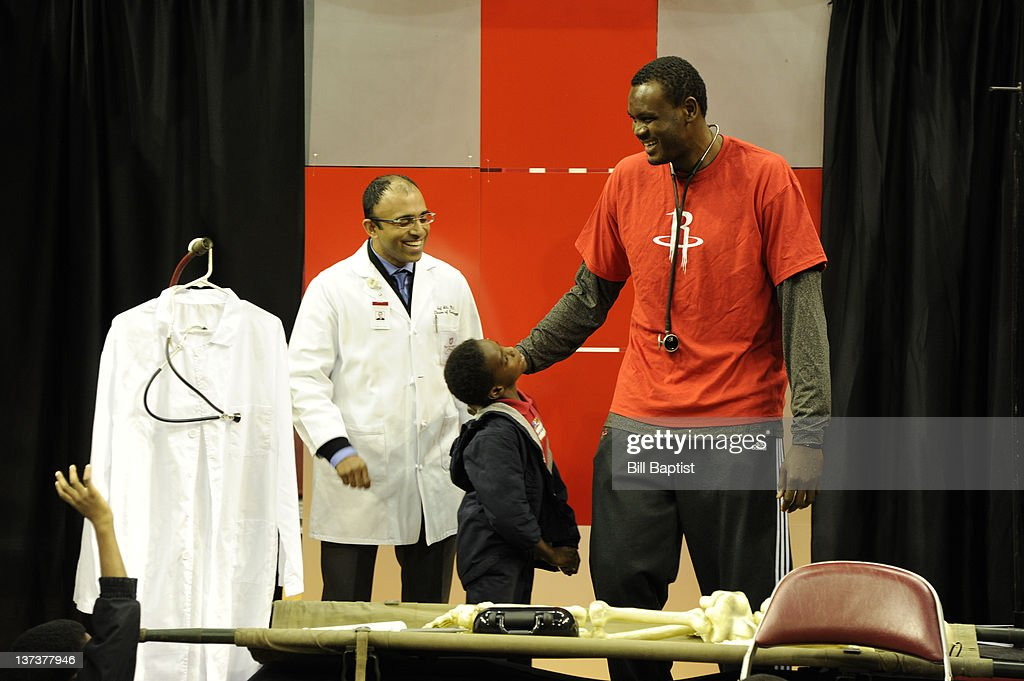 <a gi-track='captionPersonalityLinkClicked' href=/galleries/search?phrase=Samuel+Dalembert&family=editorial&specificpeople=202026 ng-click='$event.stopPropagation()'>Samuel Dalembert</a> #21 of the Houston Rockets talks with a child during Read Play Win on January 18, 2012 at the Toyota Center in Houston, Texas.