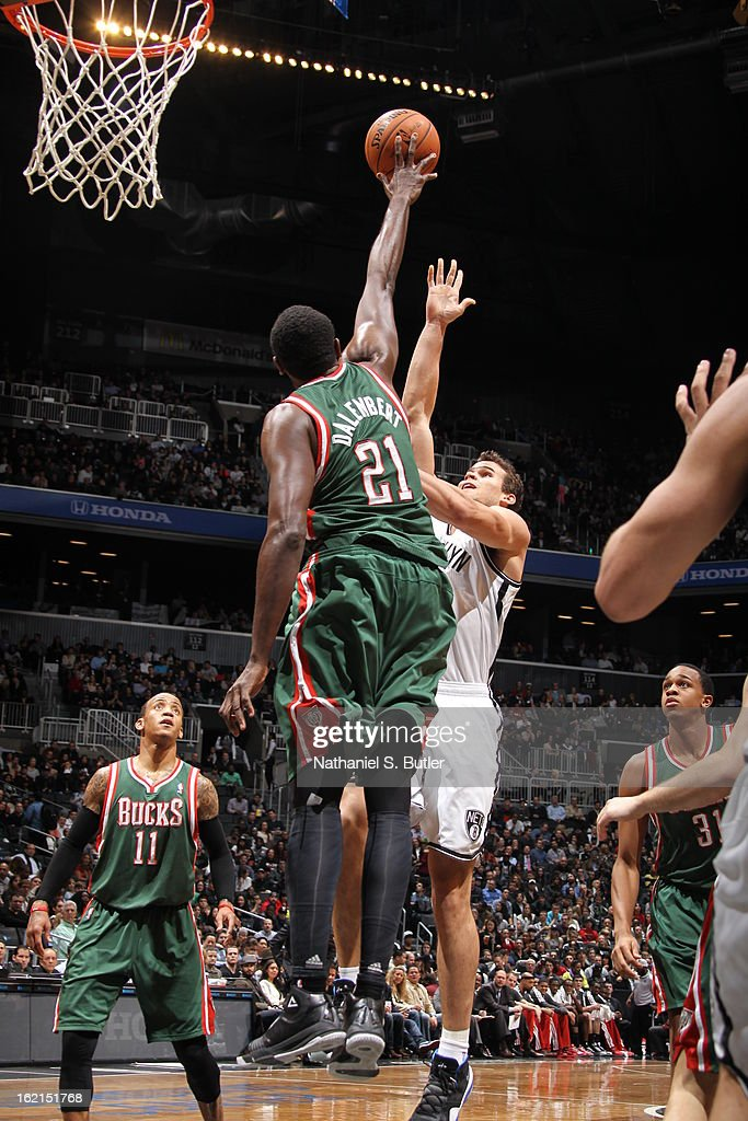 Samuel Dalembert #21 of the Milwaukee Bucks blocks a shot against Kris Humphries #43 of the Brooklyn Nets on February 19, 2013 at the Barclays Center in the Brooklyn borough of New York City.