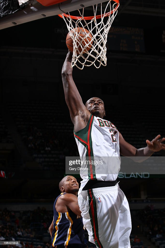 Samuel Dalembert #21 of the Milwaukee Bucks dunks against David West #21 of the Indiana Pacers during the NBA game on November 14, 2012 at the BMO Harris Bradley Center in Milwaukee, Wisconsin.