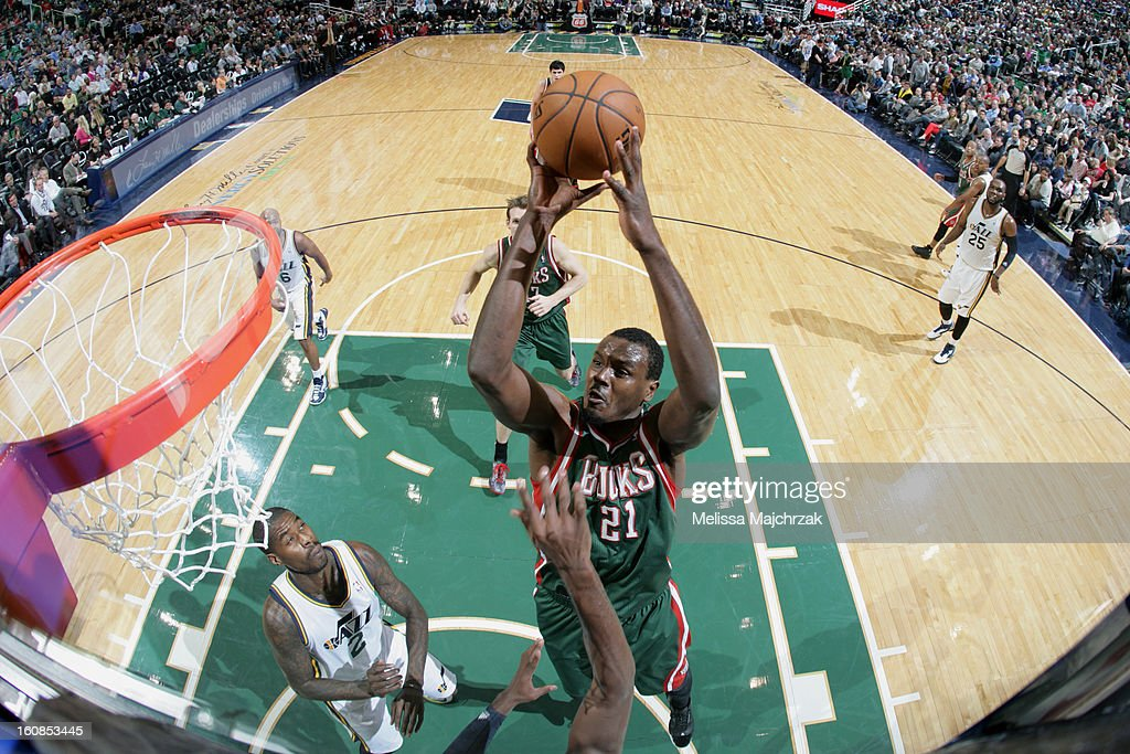 <a gi-track='captionPersonalityLinkClicked' href=/galleries/search?phrase=Samuel+Dalembert&family=editorial&specificpeople=202026 ng-click='$event.stopPropagation()'>Samuel Dalembert</a> #21 of the Milwaukee Bucks dunks against <a gi-track='captionPersonalityLinkClicked' href=/galleries/search?phrase=Marvin+Williams&family=editorial&specificpeople=206784 ng-click='$event.stopPropagation()'>Marvin Williams</a> #2 of the Utah Jazz at Energy Solutions Arena on February 06, 2013 in Salt Lake City, Utah.