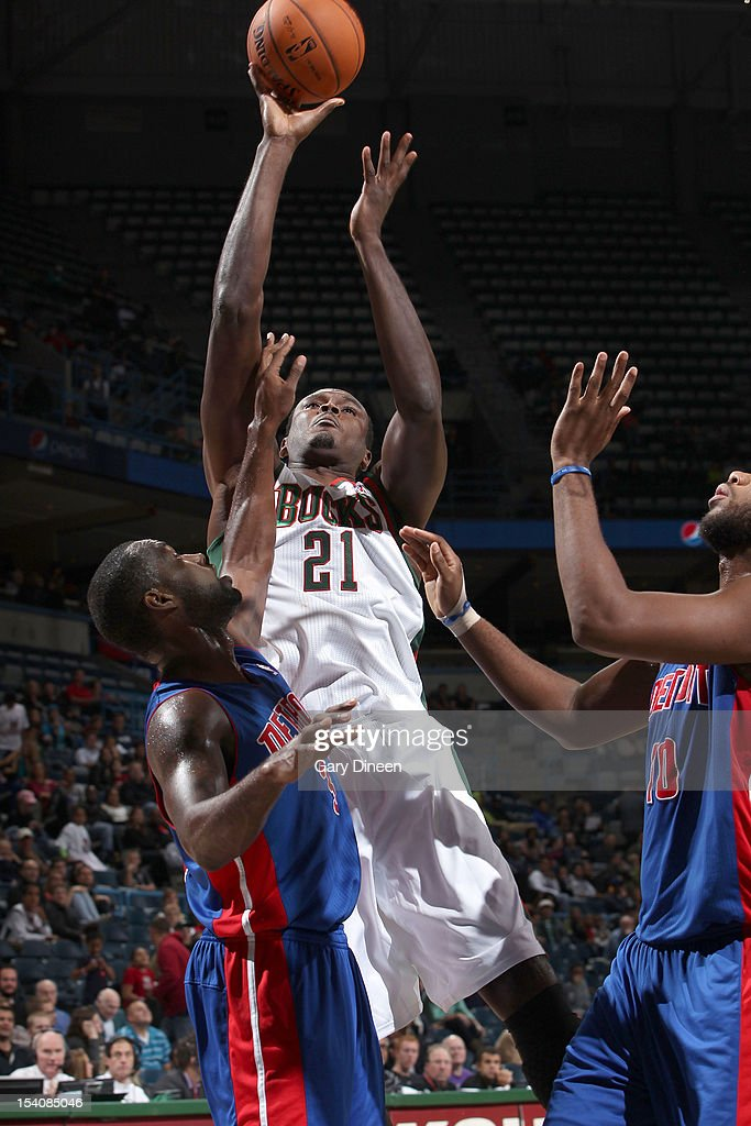 <a gi-track='captionPersonalityLinkClicked' href=/galleries/search?phrase=Samuel+Dalembert&family=editorial&specificpeople=202026 ng-click='$event.stopPropagation()'>Samuel Dalembert</a> #21 of the Milwaukee Bucks shoots against (L-R) <a gi-track='captionPersonalityLinkClicked' href=/galleries/search?phrase=Rodney+Stuckey&family=editorial&specificpeople=4375687 ng-click='$event.stopPropagation()'>Rodney Stuckey</a> #3 and <a gi-track='captionPersonalityLinkClicked' href=/galleries/search?phrase=Greg+Monroe&family=editorial&specificpeople=5042440 ng-click='$event.stopPropagation()'>Greg Monroe</a> #10 of the Detroit Pistons during the NBA preseason game on October 13, 2012 at the BMO Harris Bradley Center in Milwaukee, Wisconsin.
