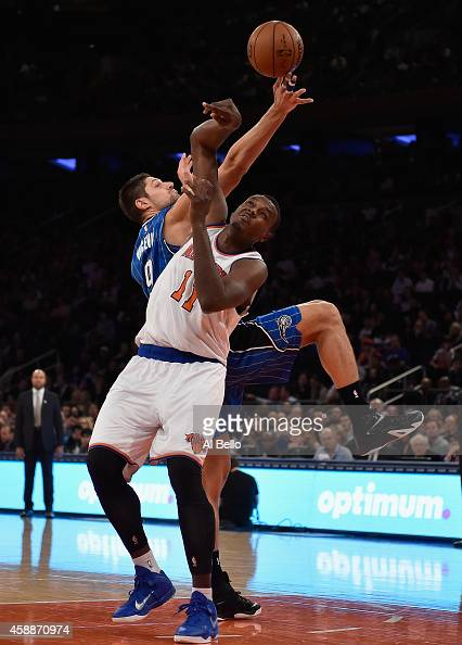 Samuel Dalembert of the New York Knicks and Nikola Vucevic of the Orlando Magic leap for a rebound during their game at Madison Square Garden on...