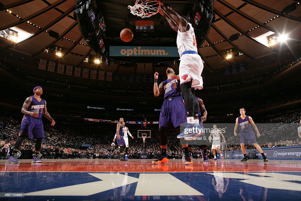Samuel Dalembert of the New York Knicks dunks against the Phoenix Suns during the game on December 20 2014 at Madison Square Garden in New York City...