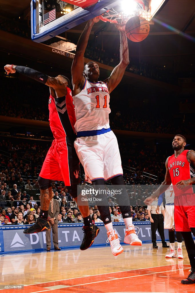 Samuel Dalembert of the New York Knicks dunks against the Toronto Raptors during a game at Madison Square Garden on October 13 2014 in New York City...