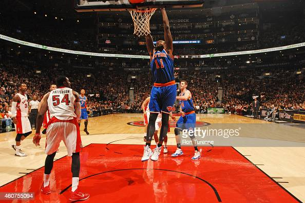 Samuel Dalembert of the New York Knicks dunks against the Toronto Raptors during the game on December 21 2014 at the Air Canada Centre in Toronto...