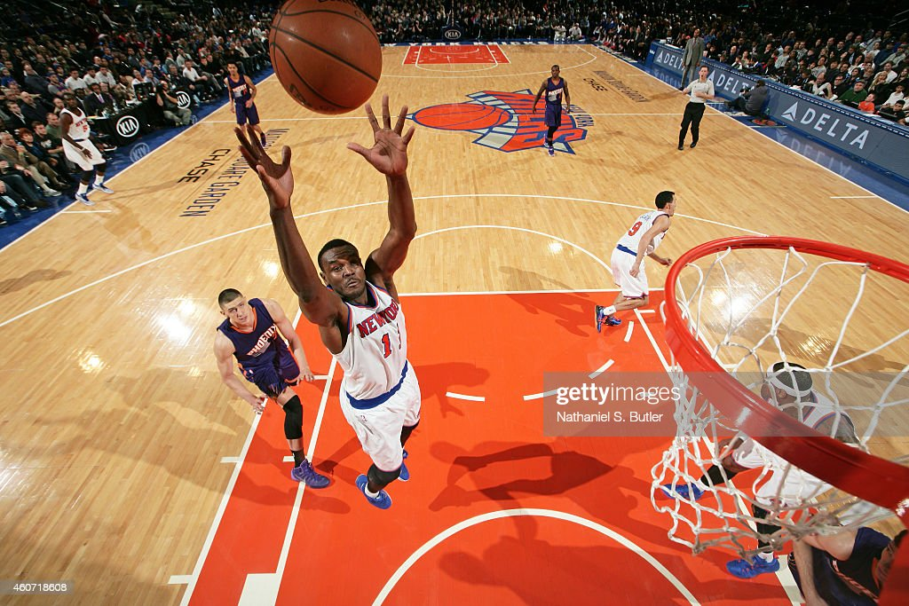 Samuel Dalembert of the New York Knicks goes up for a rebound against the Phoenix Suns during the game on December 20 2014 at Madison Square Garden...