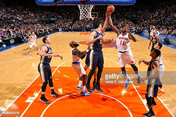 Samuel Dalembert of the New York Knicks grabs a rebound against the Utah Jazz on November 14 2014 at Madison Square Garden in New York City NOTE TO...