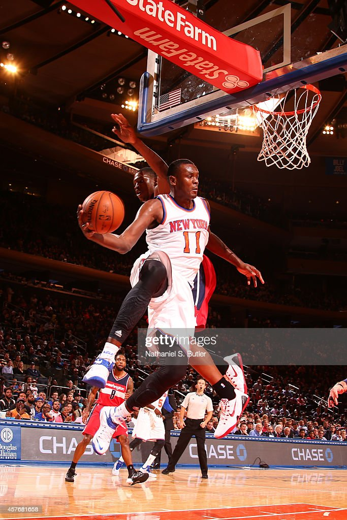 Samuel Dalembert of the New York Knicks passes the ball against the Washington Wizards during a game at Madison Square Garden in New York City on...