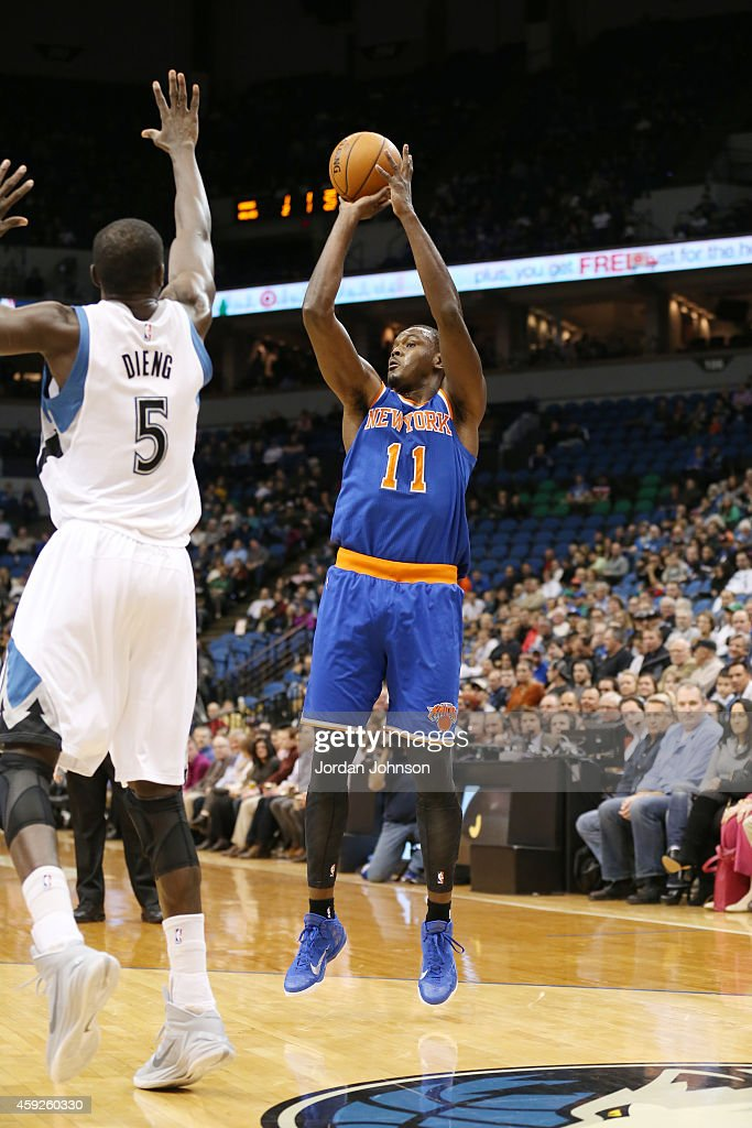 Samuel Dalembert of the New York Knicks shoots against Gorgui Dieng of the Minnesota Timberwolves during the game on November 19 2014 at Target...