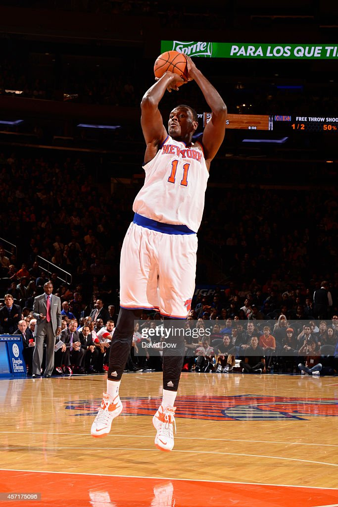 Samuel Dalembert of the New York Knicks shoots during a game against the Toronto Raptors at Madison Square Garden on October 13 2014 in New York City...