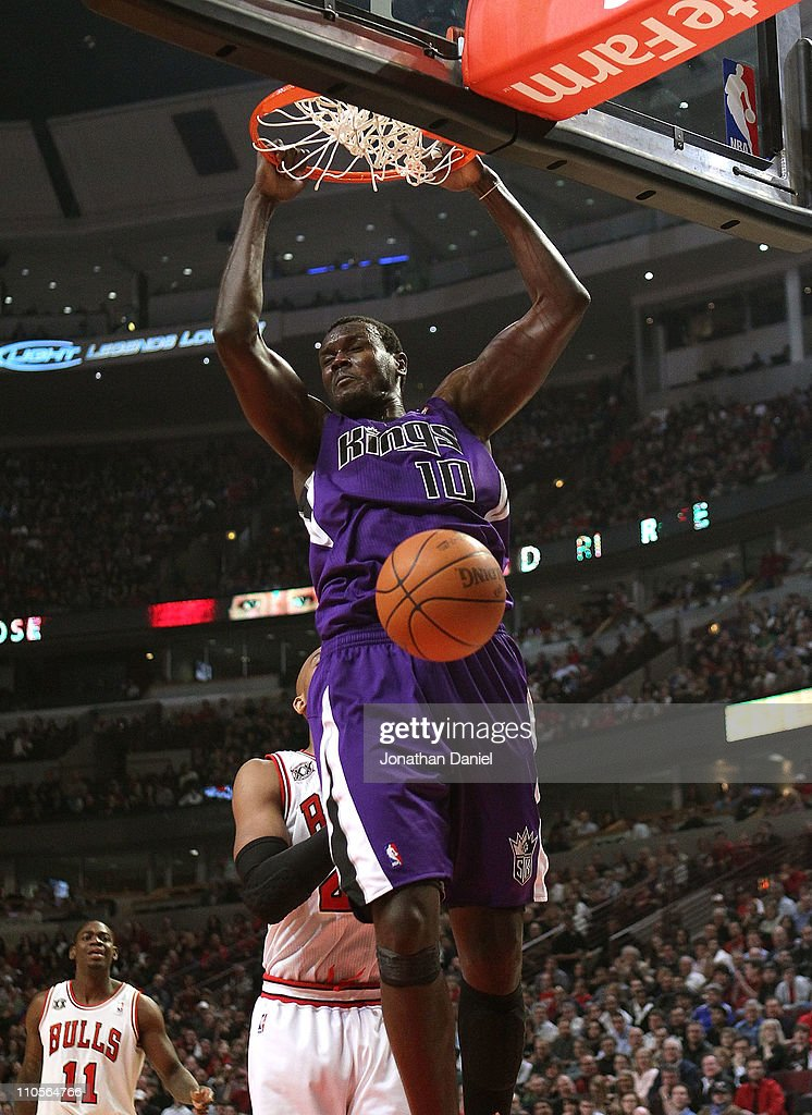 Samuel Dalembert of the Sacramento Kings dunks the ball against the Chicago Bulls at the United Center on March 21 2011 in Chicago Illinois NOTE TO...