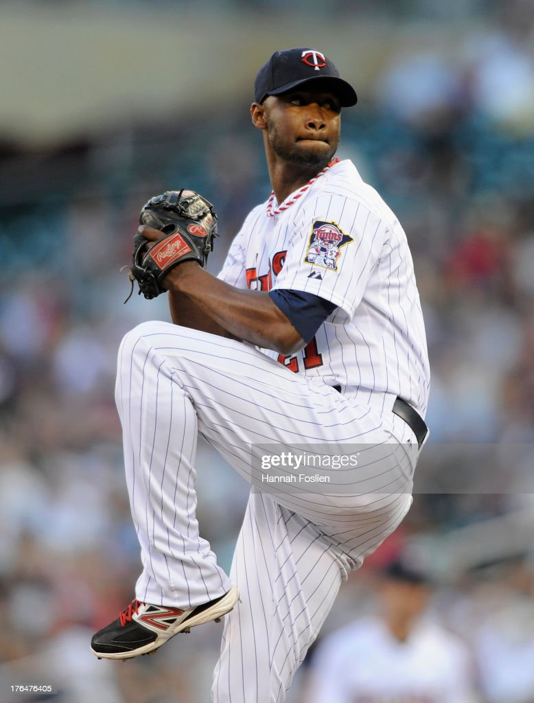 <a gi-track='captionPersonalityLinkClicked' href=/galleries/search?phrase=Samuel+Deduno&family=editorial&specificpeople=5734325 ng-click='$event.stopPropagation()'>Samuel Deduno</a> #21 of the Minnesota Twins delivers a pitch against the Cleveland Indians during the first inning of the game on August 13, 2013 at Target Field in Minneapolis, Minnesota.