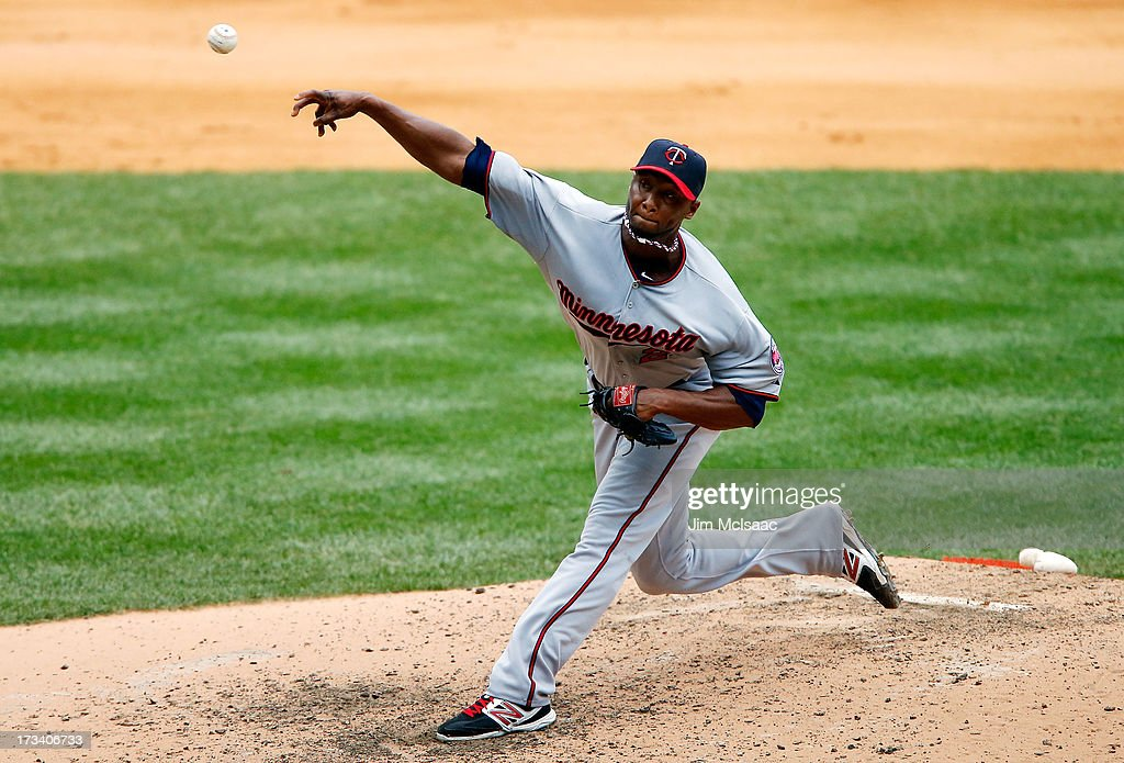 <a gi-track='captionPersonalityLinkClicked' href=/galleries/search?phrase=Samuel+Deduno&family=editorial&specificpeople=5734325 ng-click='$event.stopPropagation()'>Samuel Deduno</a> #21 of the Minnesota Twins pitches against the New York Yankees at Yankee Stadium on July 13, 2013 in the Bronx borough of New York City.