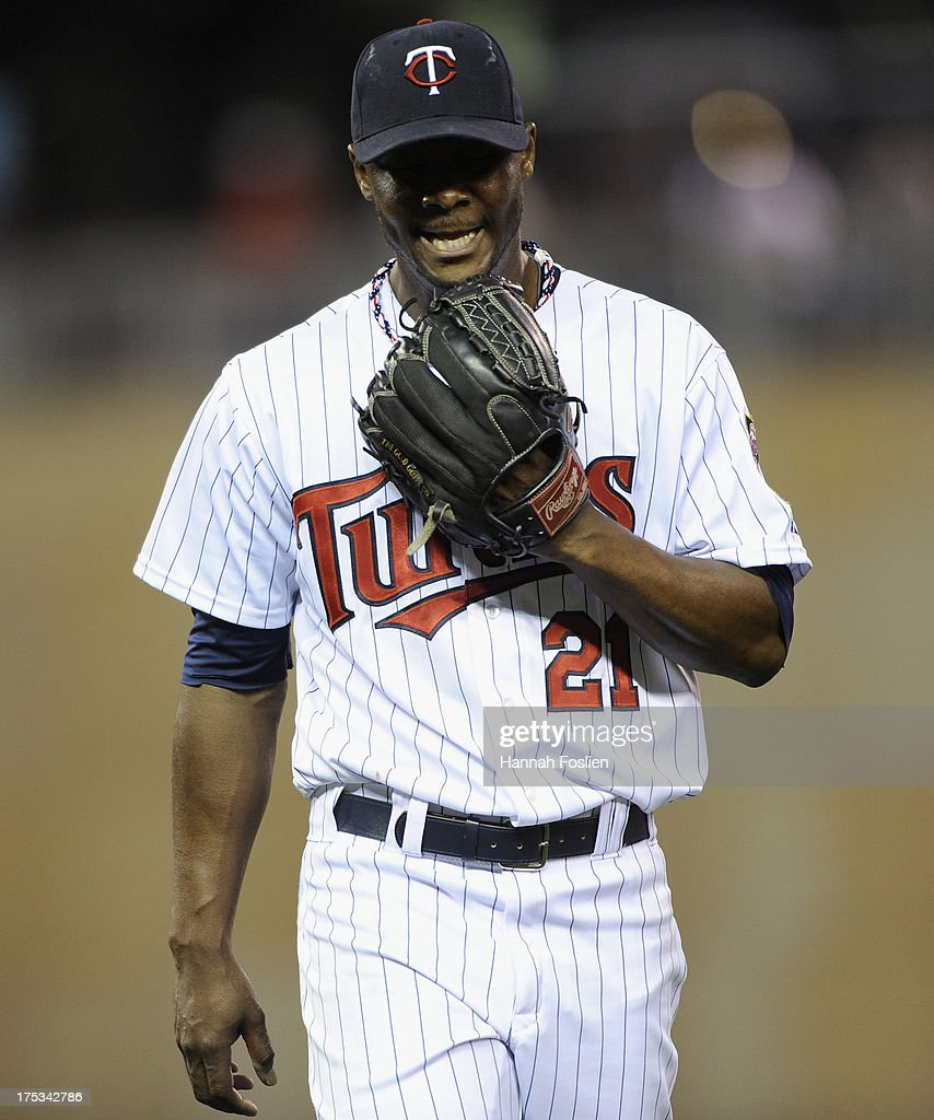 Samuel Deduno #21 of the Minnesota Twins reacts after the top of the fifth inning of the game against the Houston Astros on August 2, 2013 at Target Field in Minneapolis, Minnesota.