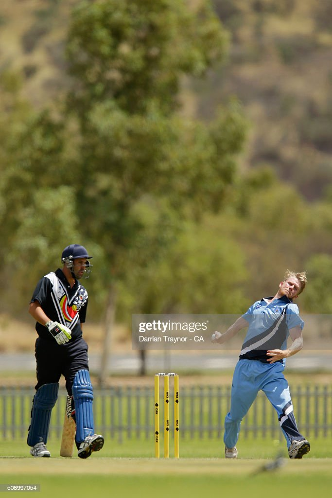 Samuel Doggett of New South Wales bowls against Victoria on day 1 of the National Indigenous Cricket Championships on February 8, 2016 in Alice Springs, Australia.