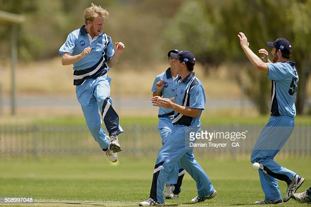 Samuel Doggett of New South Wales celebrates the wicket of Rohan Best of Victoria on day 1 of the National Indigenous Cricket Championships on...
