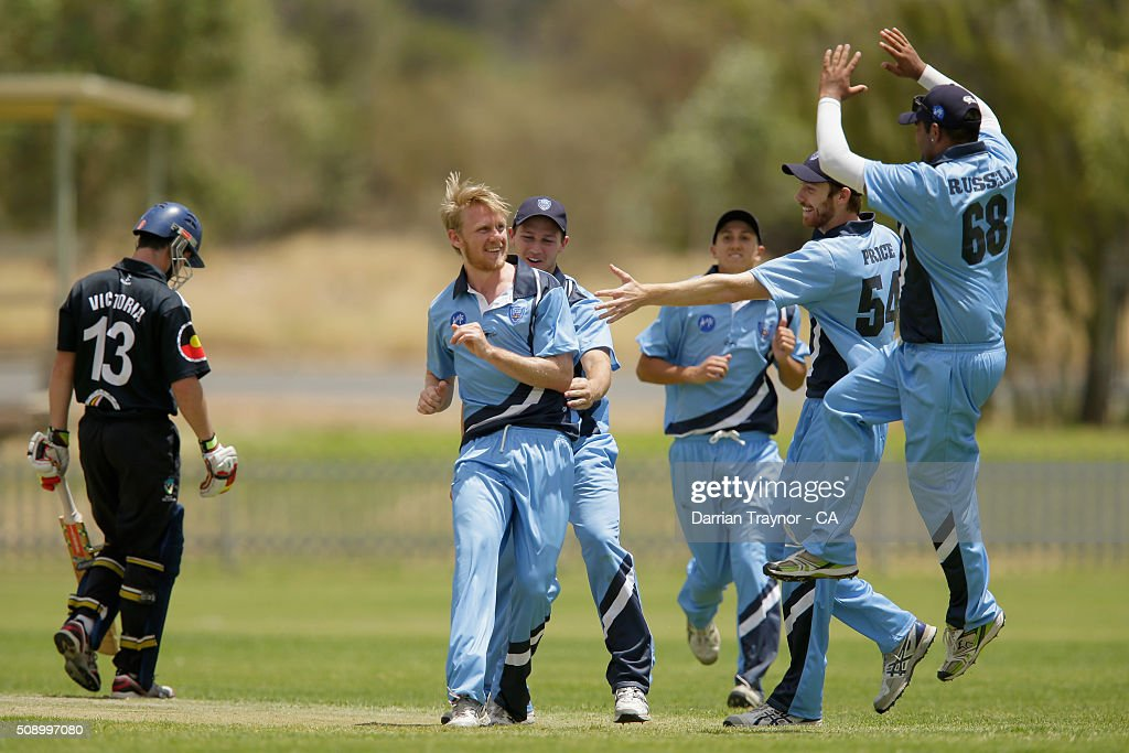 Samuel Doggett of New South Wales celebrates with team mates after taking the wicket of Rohan Best of Victoria on day 1 of the National Indigenous Cricket Championships on February 8, 2016 in Alice Springs, Australia.