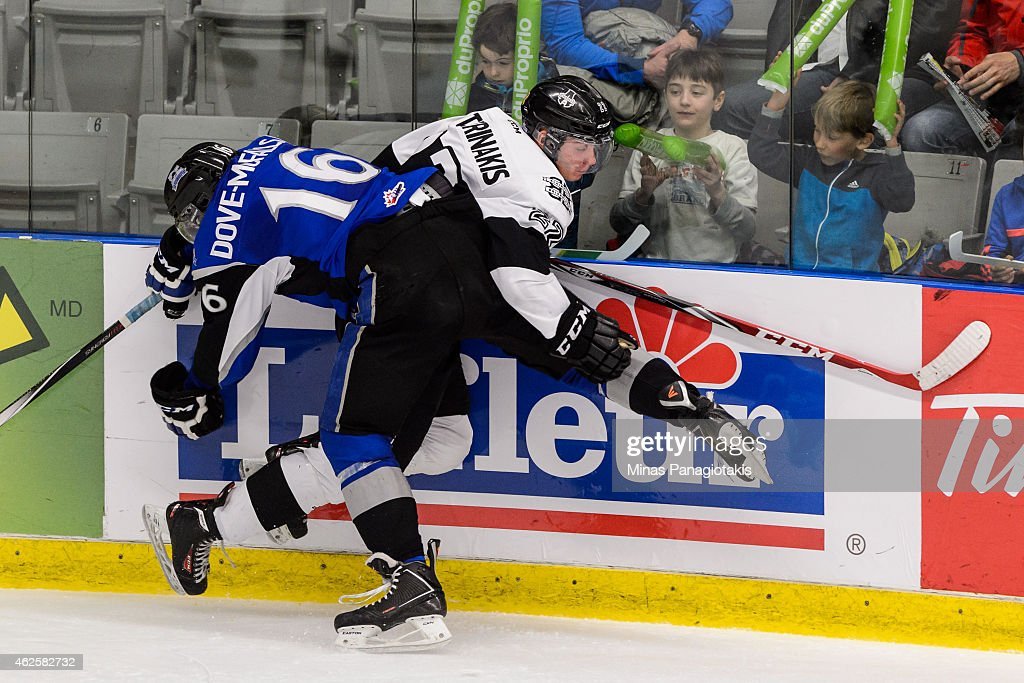 Samuel Dove-McFalls #16 of the Saint John Sea Dogs pins Alexander Katerinakis #22 of the Blainville-Boisbriand Armada to the boards during the QMJHL game at the Centre Excellence Rousseau on January 31, 2015 in Blainville-Boisbriand, Quebec, Canada. The Blainville-Boisbriand Armada defeated the Saint John Sea Dogs 4-0.