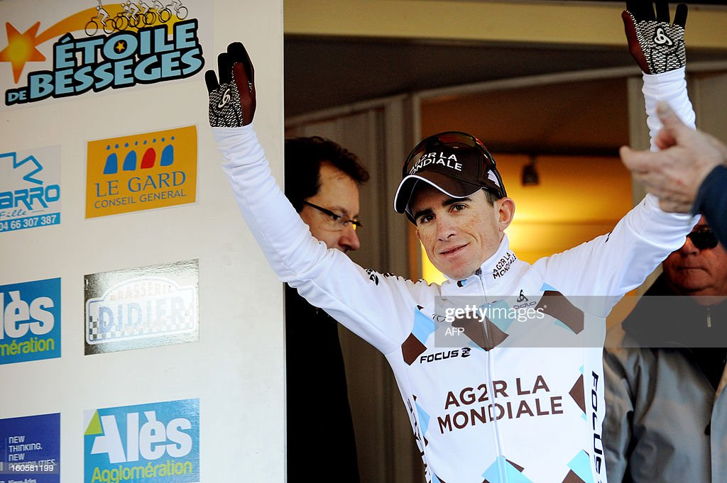 Samuel Dumoulin of France celebrates on the podium after winning the fifth stage of the 43rd edition of the Etoile de Besseges cycling race on February 3, 2013 in Ales, southern France.
