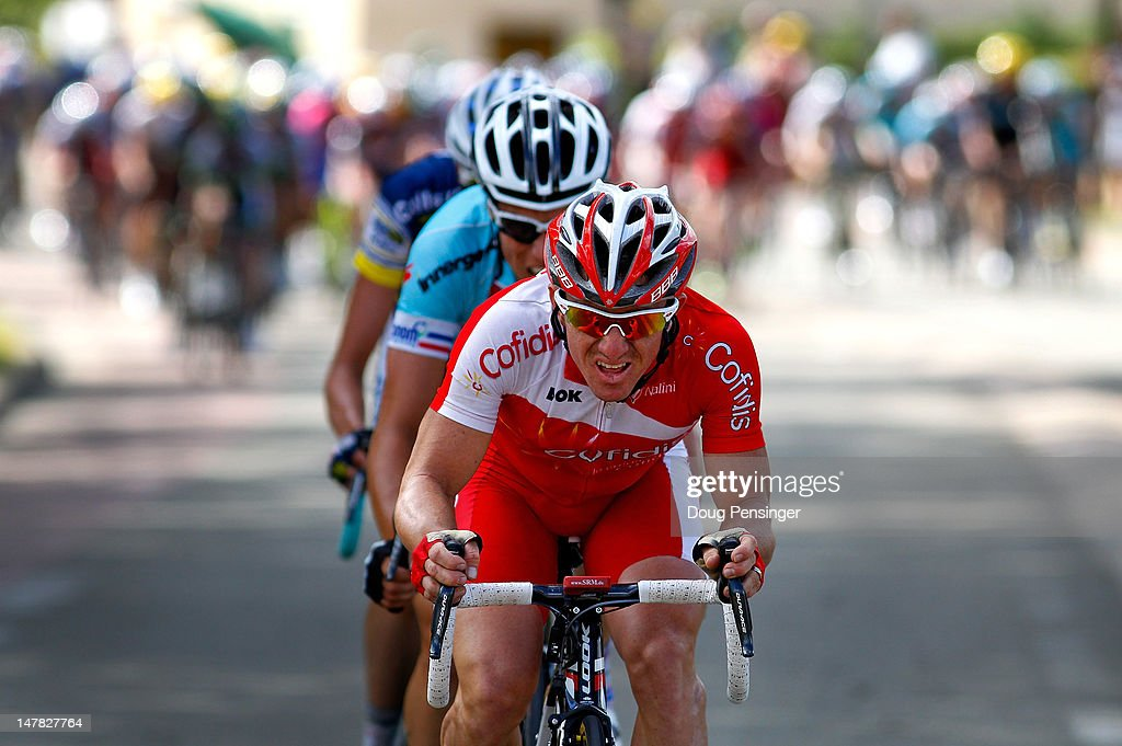 <a gi-track='captionPersonalityLinkClicked' href=/galleries/search?phrase=Samuel+Dumoulin&family=editorial&specificpeople=760365 ng-click='$event.stopPropagation()'>Samuel Dumoulin</a> of France riding for Cofidis leads <a gi-track='captionPersonalityLinkClicked' href=/galleries/search?phrase=Sylvain+Chavanel&family=editorial&specificpeople=547829 ng-click='$event.stopPropagation()'>Sylvain Chavanel</a> of France riding for Omega Pharma-QuickStep and Wout Poels of The Netherlands riding for Vacansoleil-DCM as they launch a counter attack that was neutralized with 3.5 kilomters remaining in stage four of the 2012 Tour de France from Abbeville to Rouen on July 4, 2012 in Rouen, France.